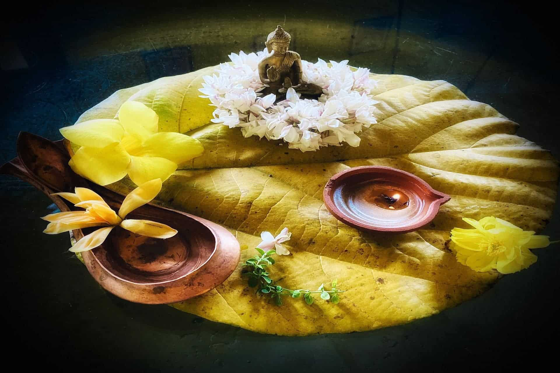 A puja offering with lamps and flowers